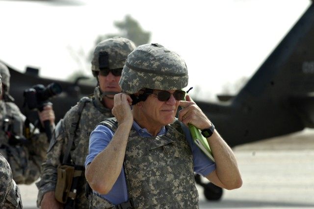 Dr. Malcolm Ross O'Neill, Assistant Secretary of the Army (Acquisition, Logistics, and Technology), takes off his Kevlar helmet after stepping off of an Enhanced Combat Aviation Brigade, 1st Infantry Division helicopter on Camp Taji, Iraq, Sept. 26. O'Neill visited the brigade's headquarters to be briefed on the intent and progress of its mission. (U.S. Army photo by Spc. Roland Hale, eCAB, 1st Inf. Div. PAO)