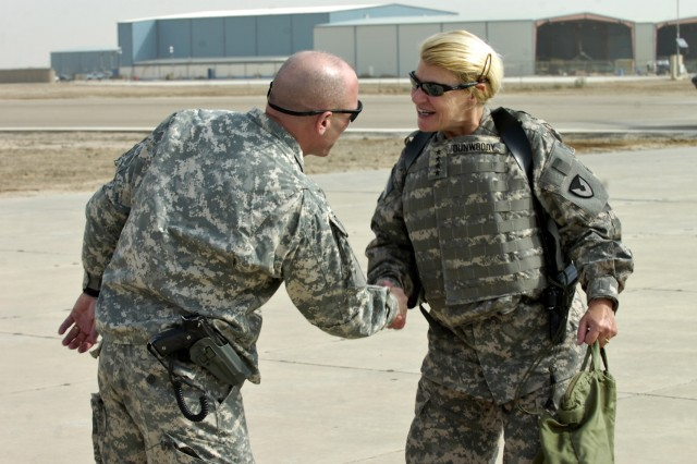 Col. Frank Muth, commander of the Enhanced Combat Aviation Brigade, 1st Infantry Division, greets Gen. Ann E. Dunwoody, the Army's first female four-star general, as she arrives on Camp Taji, Iraq to attend a briefing on the brigade's mission and progress in Iraq. (U.S. Army photo by Spc. Roland Hale, eCAB, 1st Inf. Div. PAO)