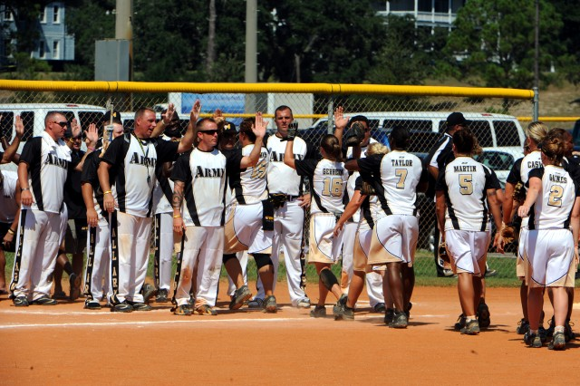 Members of the All-Army Men's Softball Team offer high-fives to the All-Army Women's Softball Team as they leave the field after a gold-medal-clinching 7-3 victory over All-Air Force on Sept. 21 in the 2010 Armed Forces Softball Championships at Naval Air Station Pensacola, Fla.