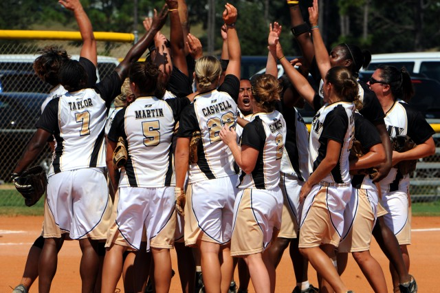 The All-Army Women's Softball Team celebrates a gold-medal-clinching 7-3 victory over All-Air Force on Sept. 21 at the 2010 Armed Forces Softball Championships at Naval Air Station Pensacola, Fla.