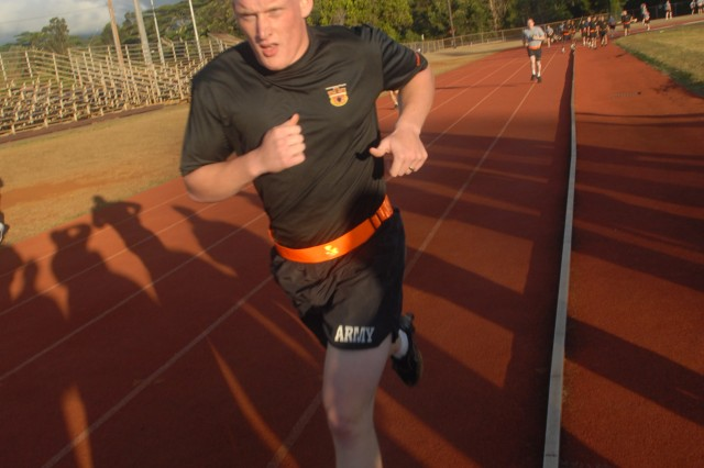 SCHOFIELD BARRACKS, Hawaii - Private First Class Joshua Collins, a paralegal specialist from the 130th Engineer Brigade, completes the Army Physical Fitness Test as part of the Paralegal Warrior Challenge, an annual event hosted by the U.S. Army, Pacific in Hawaii.  Eight paralegal Soldiers from units throughout the Pacific began the week-long competition which tests the tactical and technical abilities of paralegals.