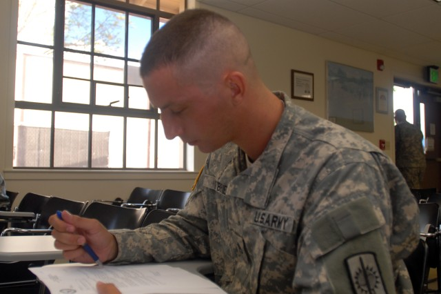 SCHOFIELD BARRACKS, Hawaii - Sgt. Matthew O'Brien, paralegal non-commissioned officer of Courts and Boards, Military Justice, 8th Military Police Brigade, Wheeler Army Airfield, conducts a correspondence review as part of the written examination portion of the 3rd annual Paralegal Warrior Challenge. Eight paralegal Soldiers from throughout the Pacific have been selected to compete in the week  filled with events testing both the tactical and technical abilities of paralegals.
