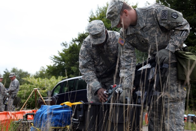 Spc. Stephen Steinbrugge and Staff Sgt. Ralph Lahens, chemical, biological, radiological and nuclear specialists with the 773rd Civil Support Team, unpack a detector used to monitor dangerous chemicals during a training exercise at Rhine Ordnance Barracks Sept 16. The 773rd CST is the only active Army Reserve civil support team stationed outside of the continental U.S. and its territories and is capable of deploying in support of U.S. Army Europe's response to a chemical, biological, radiological and/or nuclear incident.