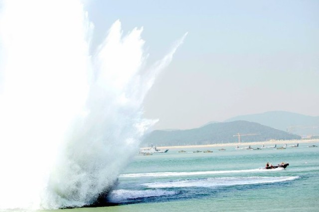 Navy divers speed away as explosions rock the Inchon harbor during ceremonies marking the 60th anniversary of the Inchon Landing, Sept. 15, 2010.