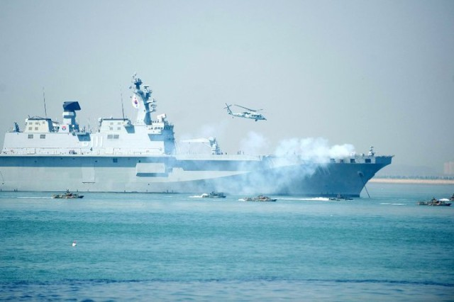 ROK military vessel Dokdo, returns fire as smaller boats rush toward the Inchon harbor during ceremonies marking the 60th anniversary of the Inchon Landing, Sept. 15, 2010.