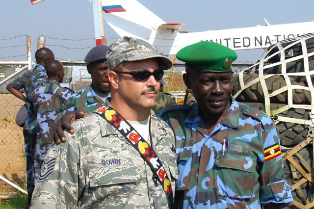 U.S. Air Force Tech. Sgt. Bryan Quinn (left), Pope Air Force Base, N.C., poses for a photo with a Uganda People's Defense Force logistician during a hands-on segment of Uganda ADAPT 2010, a mentoring program conducted in Entebbe, Uganda, that resulted in certifying 25 soldiers as C-130 aircraft load planners.