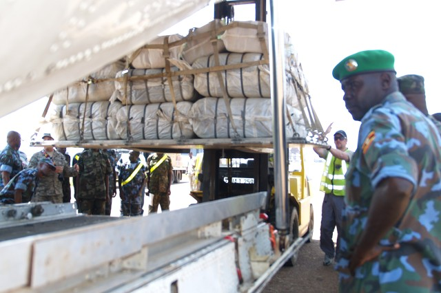 Uganda People's Defense Force (UPDF) logisticians load palletized material during a hands-on segment of Uganda ADAPT 2010, a mentoring program conducted in Entebbe, Uganda, that resulted in certifying 25 soldiers as C-130 aircraft load planners.