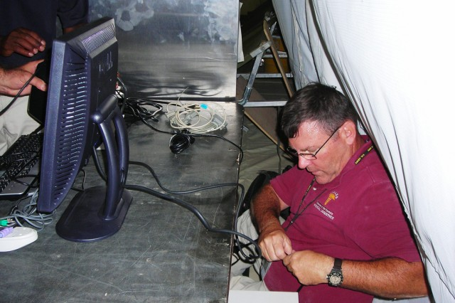 MC4's Rocky Henemyer installs the DMLSS server, enabling personnel with the 31st Combat Support Hospital at Camp Dwyer, Afghanistan, to electronically manage medical supplies.
