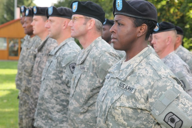 Members of the 457th Civil Affairs Battalion stand in formation at the 361st Civil Affairs Brigade's activation ceremony Sept. 17 on Daenner Kaserne's parade field. The unit changed their patch from the 7th Civil Support Command to the 361st Civil Affairs Brigade. The sunburst in the middle of the patch is symbolic of authority, enlightenment and wisdom.