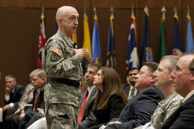 Maj. Gen. Nick Justice, commanding general of the Army Research, Development and Engineering Command, leads a question and answer Town Hall meeting with ARDEC employees at Picatinny Arsenal, Sept. 22.