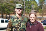 Staff Sergeant Robert Miller standing with his mother