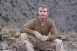 Staff Sergeant Robert Miller sitting in mountains of Afghanistan