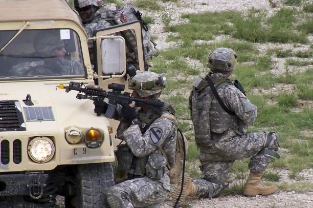 FORT HOOD, Texas - Troopers from C Troop, 6th Squadron, 9th Cavalry Regiment, 3rd Brigade Combat Team, 1st Cavalry Division, pull security while conducting a cordon and search on the Boaz Combined Arms Combat Training Facility as part of a Greywolf field training exercise Sept. 20-22.