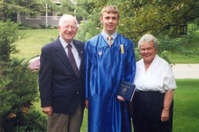 High school graduation with the grandparents.