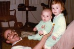 Staff Sergeant Robert Miller and sister sitting on their father as children