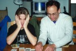 Staff Sergeant Robert Miller making faces while playing board games with his father