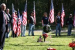 People at the Memorial Service holding American flags