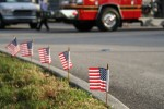 Small American flags at the curb