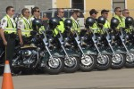 Police officers standing near their motorcycle