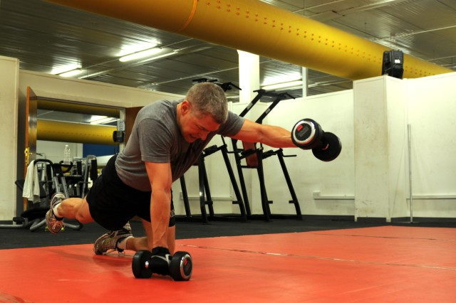 Maj. Nicholas Simontis, United States Division-South secretary of the general staff, does a set of planks during his daily fitness routine at a gym in Basra Sept. 27. Simontis, a tri-athlete, plans to compete after his tour in Iraq.