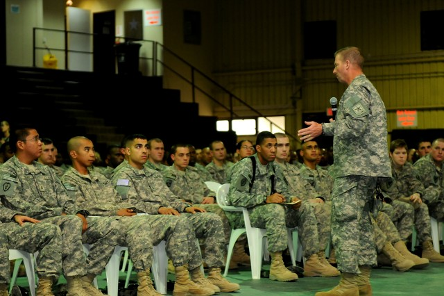"Sergeant Major of the Army Kenneth O. Preston addresses a crowd of Soldiers during a town hall meeting at Contingency Operating Base Speicher, near Tikrit, Iraq. Sergeant Major of the Army Preston spoke about various topics, to include upcoming changes in the Army Physical Fitness Test and promotion points, as well as answered a series of questions from Soldiers in the audience. Sergeant Major of the Army Preston also encouraged the Soldiers to teach, mentor and coach fellow Soldiers. ""The most important thing you can do as an NCO is to teach, share information, coach Soldiers,"" said Sgt. Maj. of the Army Preston. ""Spending that extra time with your Soldiers is what sets you apart as an NCO. It's not always about how good you are as an NCO, it's how good your Soldiers are."""