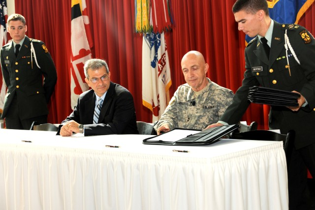 Dr. Nariman Farvardin, University of Maryland interim president, left, and Maj. Gen. Nick Justice,  commanding general, U.S. Army Research, Development and Engineering Command, prepare to sign a Cooperative Research and Development Agreement in College Park, Md., Sept. 28.