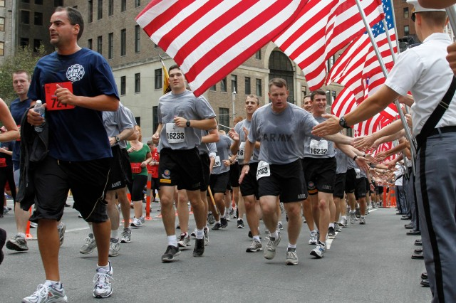 Brig. Gen. Timothy Trainor, West Point Dean of the Academic Board, joined more than 1,100 cadets in running the Tunnel to Towers, while high-fiving some of the 99 others from the Corps of Cadets lining the street with American flags in hand to support the participants in the 5K event.