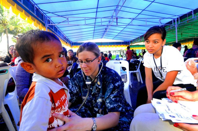 Navy Lt. Stacy Dodt examines a patient in Indonesia.