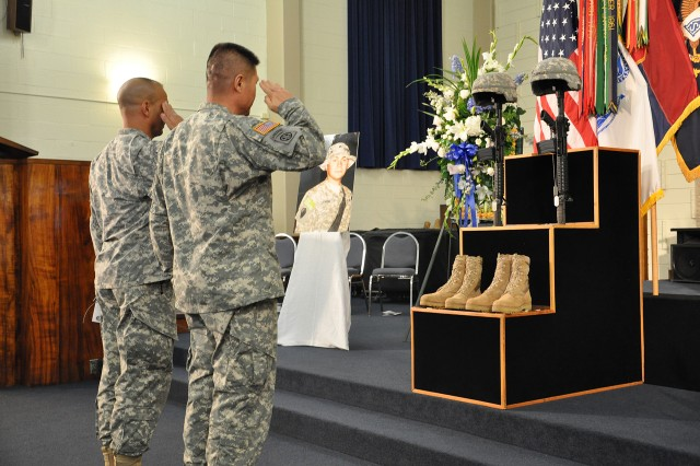 "Col. Richard Kim, commander, 3rd Brigade Combat Team ""Broncos,"" 25th Infantry Division, renders a hand salute to the military combat memorial during a memorial ceremony for family, friends, and colleagues to honor the bravery and sacrifice of Staff Sgt. Philip C. Jenkins and Pfc. James F. McClamrock at the Main Post Chapel on Schofield Barracks, Hawaii, Sept. 29. Kim was one of many military leaders who paid tribute to the memory of the fallen 1st Battalion, 27th Infantry ""Wolfhound"" Soldiers. (U.S. Army photo by Sgt. Jesus J. Aranda, 25th Infantry Division Public Affairs Office)"