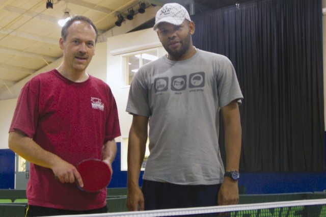 New Yorkers Robert Roberts and Will Shortz play with Anniston Army Depot's table tennis club on Sept. 14.