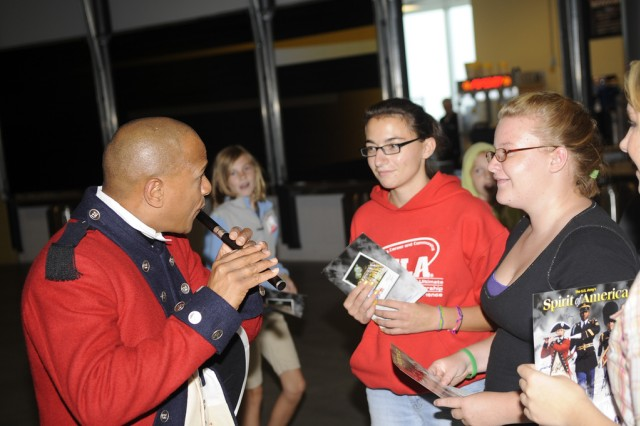 Soldiers from The Old Guard Fife and Drum Corps meet guests during Spirit of America at The Bank of Kentucky Center in Highland Heights, Ky., on Sept. 18.