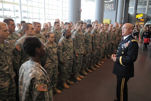 Maj. Gen. Karl R. Horst, commanding general, U.S. Army Miltiary District of Washington, greets guests before Spirit of America at Van Andel Arena in Grand Rapids, Mich. on Sept.
