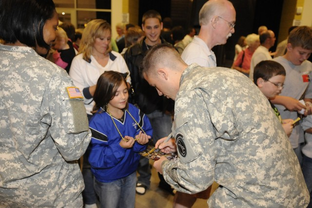 Soldiers from the 3rd U.S. Infantry Regiment (The Old Guard) meet guests during Spirit of America at The Bank of Kentucky Center in Highland Heights, Ky., on Sept. 18.
