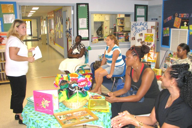 Victoria Barrera, Child, Youth and School Services (CYSS) pre-kindergarten (pre-k) teacher, addresses parents of her students about the first month of their childAca,!a,,cs education Sept. 23 during an open house at the CYSS Center on Fort McPherson.