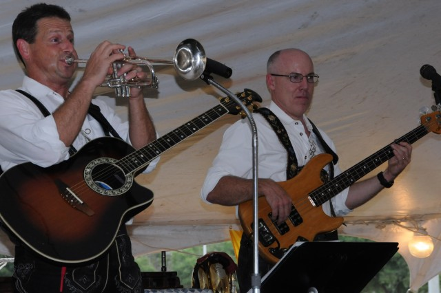 Martin Gross and Todd Campbell, members of the band The Sonnenschein Express, perform German music during Oktoberfest Sept. 24 on the post festival fields.