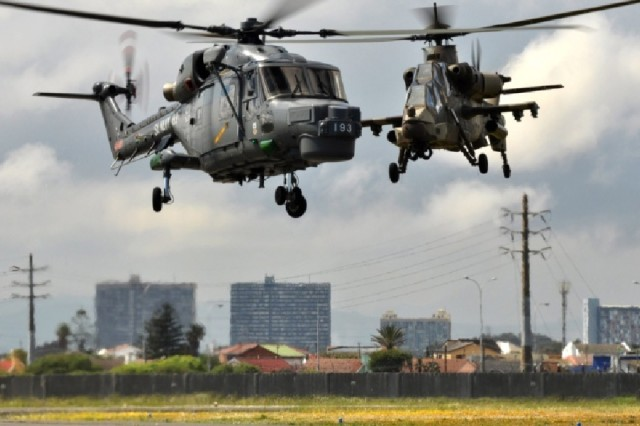 A pair of South African helicopters prepare to land during a demonstration at Air Force Base Ysterplaat, Cape Town, South Africa Sept 22.  The event is Africa's premier aerospace, general aviation, defense and security expo that includes a world class air show, dynamic vehicle demonstrations and many other static displays.