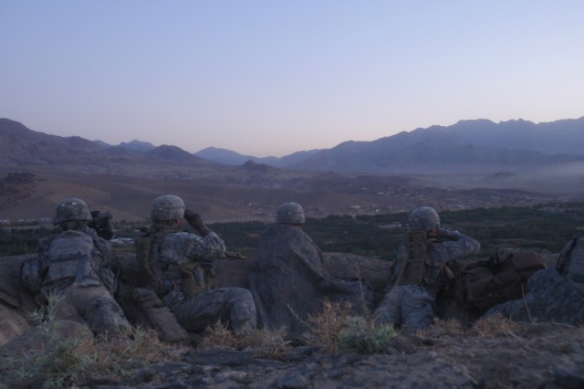 Paratroopers of 503rd Infantry Regiment, 173rd Airborne Brigade Combat Team, provide overwatch from a fighting position overlooking Chak Valley in Wardak province, east-central Afghanistan, during Operation Talon Purge, Sept. 24.