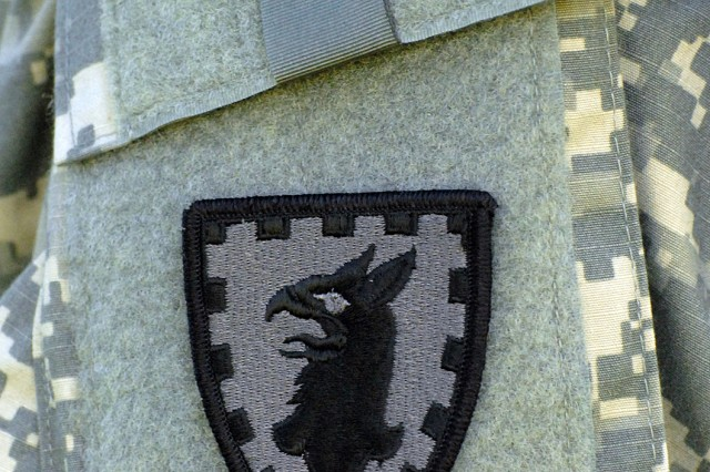 Soldiers changed their shoulder sleeve insignia during the activation ceremony for the 15th Military Police Brigade Sept. 28 on Main Parade at Fort Leavenworth, Kan. The 705th and 40th MP Internment and Resettlement Battalions fall under the brigade.