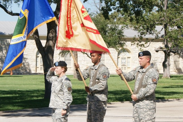 Col. Mary E. Garr, commander of the 502nd Mission Support Group, offers a salute with the colors of the 502nd Mission Support Group and the Fort Sam Houston Army Support Activity at the Fort Sam Houston Transfer of Authority ceremony Sept. 30. The ceremony marked the separation of the 502nd and the ASA and the incorporation of Fort Sam Houston into the new, Air Force-led Joint Base San Antonio.