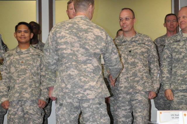 Maj. Gen. Bernard S. Champoux, commanding general, 25th Infantry Division, recognizes 25th Inf. Div. Soldiers, Officers and Department of the Army employees for their significant role during the two-week Mission Readiness Exercise the Division went through for the upcoming deployment to Iraq, by presenting Certificate of Appreciation at the Post Conference Room, Schofield Barracks, Hawaii, Sept. 30.