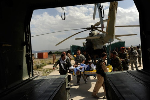 U.S. Soldiers and flight medics with the Afghan National Army Air Corps, transport a patient from an Mi-17 helicopter to an ambulance for transport to the hospital at Forward Operating Base Salerno, Afghanistan, May 12, 2010.