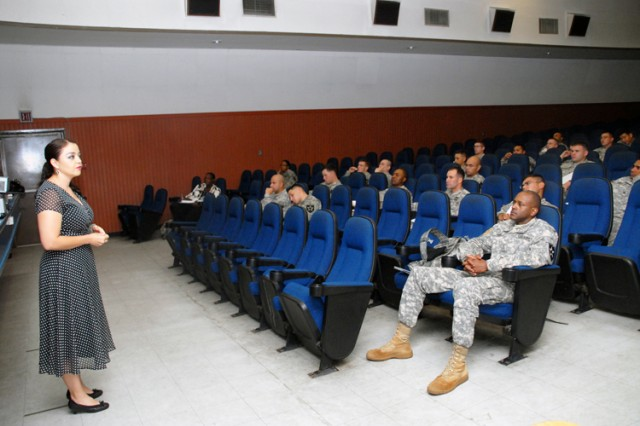 Franciela Itule, U.S. Army Pacific Command Combined Federal Campaign coordinator, talks to 45 unit coordinators and key people from Warrior Country about fundraising for the annual CFC charitable campaign during training Sept. 13 at Casey Garrison's movie theater.