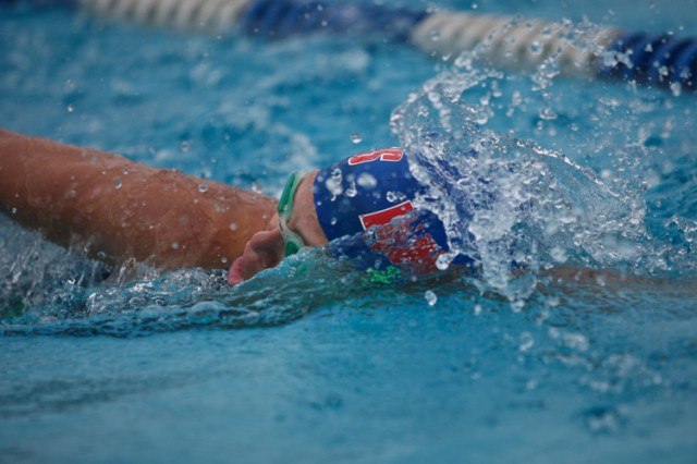 Staci Gash was the fourth participant out of the pool during the 500-meter swim at the 8th Army Team Triathlon Championship Sept. 11 at Casey Garrison's Hanson Field House. Her team of Jewel Alvis and Dawn Zitko finished first in the women's