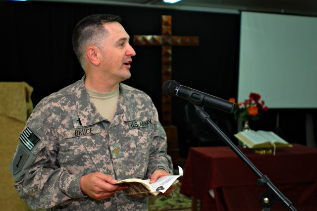 Chaplain (Maj.) Thomas Bruce, the brigade chaplain for the Enhanced Combat Aviation Brigade, 1st Infantry Division, opens a prayer service on Camp Taji, Iraq. (U.S. Army photo by Spc. Roland Hale, eCAB, 1st Inf. Div. PAO)