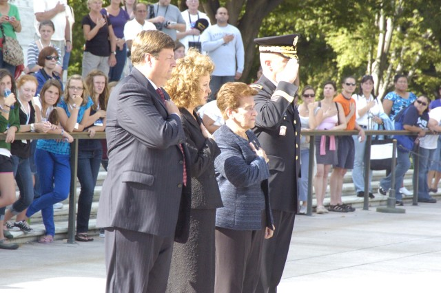 The widow of the youngest infantryman on Omaha Beach during World War Two, Joan Argenzio, renders honors during wreath laying at the Tomb of the Unknowns with Maj. Gen. Karl Horst, commander of the Joint Force Headquarters National Capital Region and the U.S. Army Military District of Washington, Pete Humes, chairman of the board with the Fredericksburg Virginia's Chamber of Commerce Military Affairs Council, and Susan  Spears, president of the Fredericksburg Chamber of Commerce.