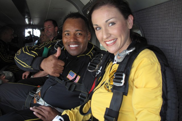 Miss North Carolina Adreinne Core gets ready for her tandem jump Sept. 28 with Golden Knights Sgt. 1st Class Mike Elliot, the tandem team leader. 