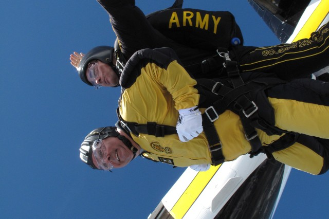 Dave Olsen, vice president and general manager of the RBC Convention Center, Raleigh, N.C. jumps with Sgt. Jon Wald during the Golden Knights tandem camp Sept. 28. The camp was held at the Golden Knights hangar at the Laurinburg-Maxton Airport, N.C.  U.S. Army photo courtesy of the Golden Knights
