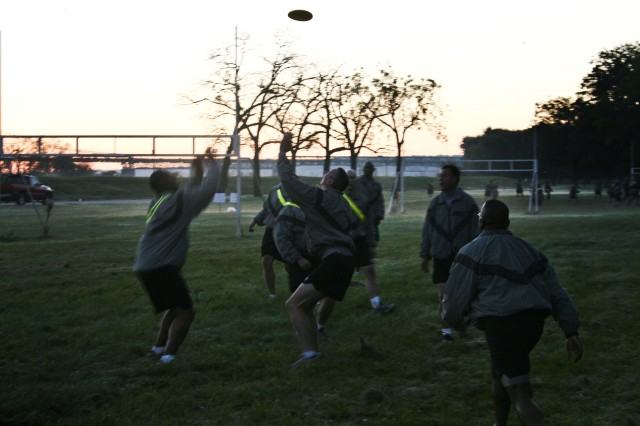"""Army Sustainment Command Soldiers vie for the Frisbee during a Frisbee football game at the Rock Island Arsenal, Ill., sports complex, Oct. 1. Arsenal servicemembers, along with their civilian counterparts, took time to reinforce the """"one team"""" mentality and play a few games. (Photo by Sgt. 1st Class Sean Riley, ASC Public Affairs)"""