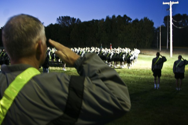 "Army Sustainment Command Soldiers salute as Reveille plays during an early morning formation at the Rock Island Arsenal, Ill., sports complex, Oct. 1. Arsenal servicemembers, along with their civilian counterparts, took time to reinforce the ""one team"" mentality and play a few games. (Photo by Sgt. 1st Class Sean Riley, ASC Public Affairs)"