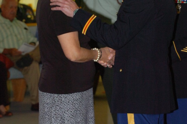 Colonel Kevin Milton Milton, garrison commander, and Command Sgt. Maj. James Ervin, garrison command sergeant major, recognize Mary Jo Holland as a Gold Star Mother, at a ceremony held at the Marne Chapel on Fort Stewart, Sept. 26.
